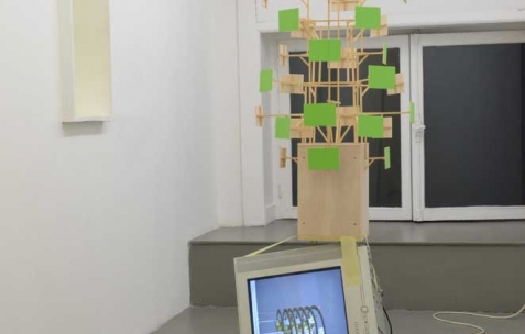 <p>Benjamin Collet & Pierre Gaignard, <strong><em>Etude pour un multiplexe décomplexé</em></strong>, 2012, bois de maquette, vert d'incrustation, tv, lecteur dvd, dimensions variables, ici : 75x100x149cm. Vue de l'exposition <em>Welcome to flowing land</em>, Néon, Lyon, 2012. Photo : Ben Bertrand Pierre / Néon.</p>