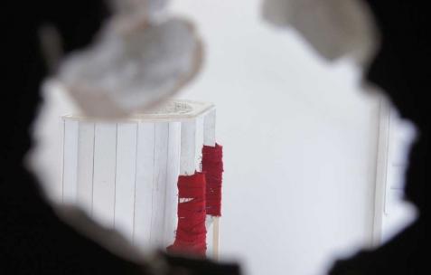 <p>Luca Monterastelli, <strong><em>La chambre des fontaines</em></strong> (détail), 2012, salle plongé dans la pénombre, tissu, plâtre, perforations, dimensions variables. Vue de l'exposition <em>Graceland</em>, Néon, Lyon, 2012. Photo : JAC / Néon.</p>